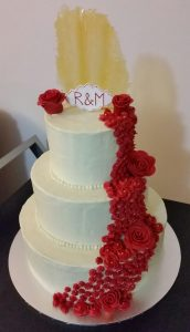 Cascading red roses cake