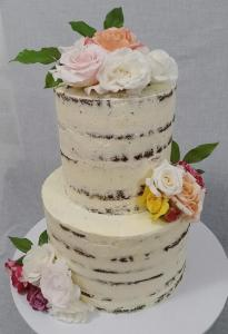 A rustic semi-naked cake with fresh florals