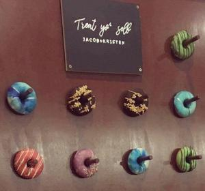 Donut wall for a wedding - Snickers, Blueberry, Bubblegum blue, Choc mint and Strawberries n cream