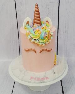Pink and rose gold unicorn cake