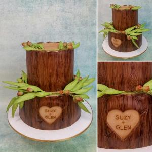 Stacked logs cake, with sugar gum nuts and gum leaves.