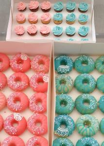Mix of donuts and mini cupcakes for a gender reveal party.