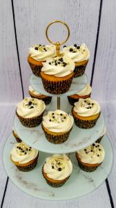 Black, white and gold themed vanilla cupcakes.