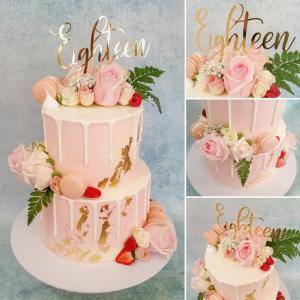 Drip cake with florals & other adornments.