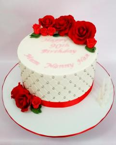 Quilted fondant cake with red sugar roses