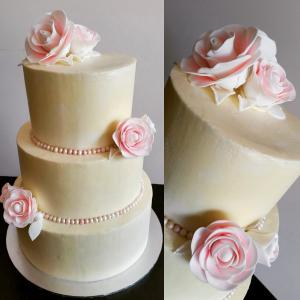 Simple wedding cake with handmade sugar roses.
